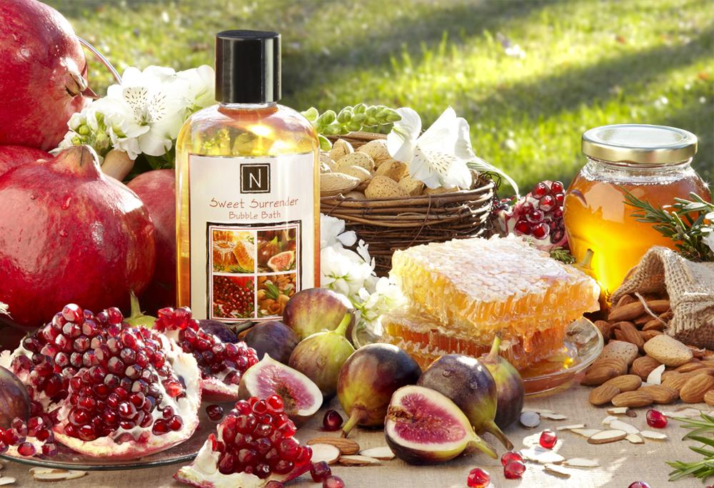 outdoor still life, honey comb, pomegranate, honey jar, figs, sunshine